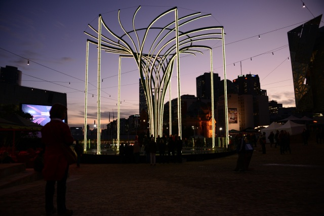 The Helix Tree in Federation Square lights up at dusk