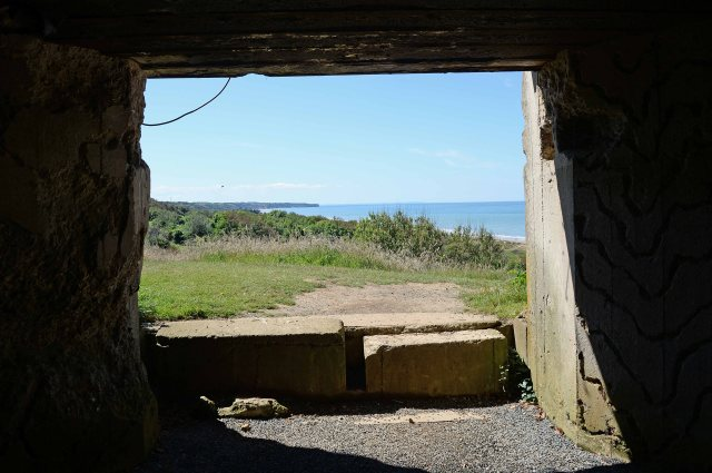 View from one of the WN62  casemates towards the western part of Omaha Beach with Pointe du Hoc in the distance